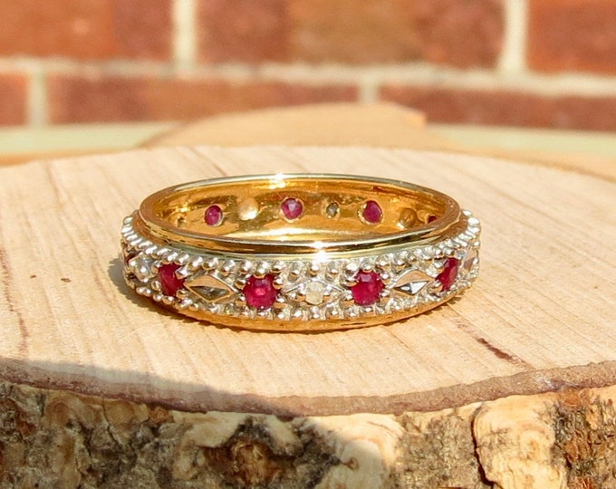 A vintage 9K yellow gold ruby and diamond full eternity ring