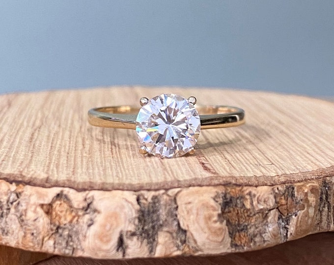 Gold CZ ring. A 9K yellow gold 1 1/2 carat cubic zirconia solitaire ring.