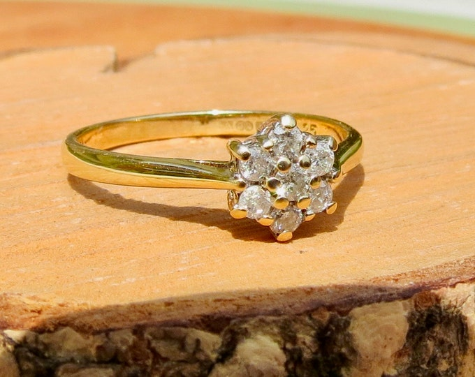 Gold diamond ring. A vintage 9K yellow gold 7 diamond cluster ring.