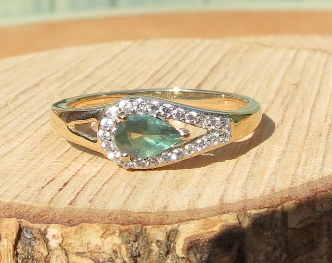 Gold labradorite ring. 10k yellow gold tear drop cut labradorite and diamond ring.