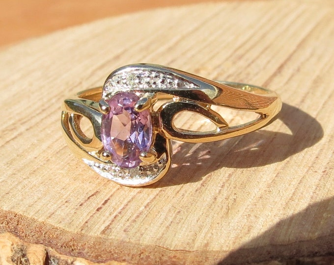 Gold amethyst ring. A vintage 9k yellow gold amethyst and diamond accented ring
