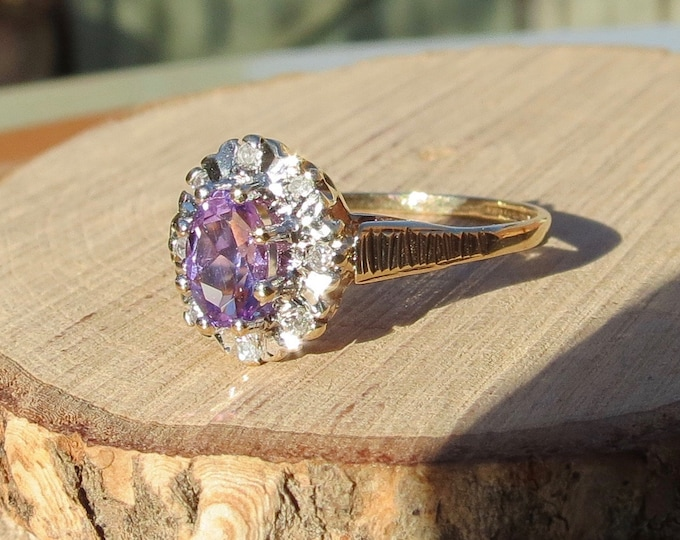 A vintage 9k yellow gold amethyst and diamond halo ring