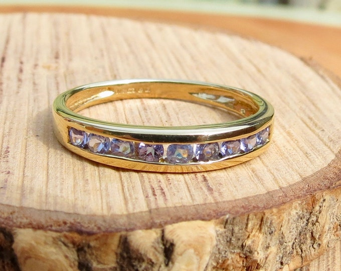 A 9k yellow gold topaz ring