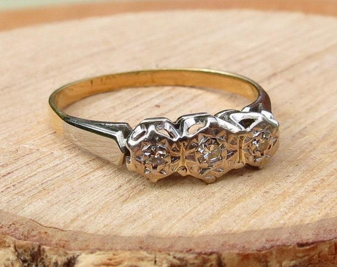 Gold diamond ring. An Art Deco 18k yellow gold platinum & diamond trilogy ring
