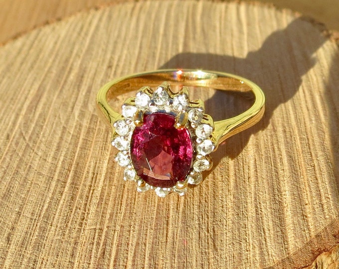 9k yellow gold, rhodolite garnet and white topaz ring,