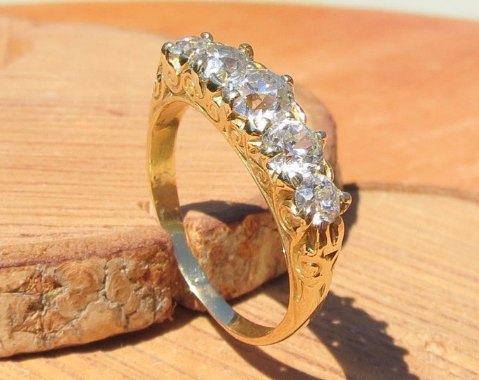 Gold diamond ring. Antique 18k yellow gold 1.2 carat diamond graduated 'old mine cut' five stone ring.