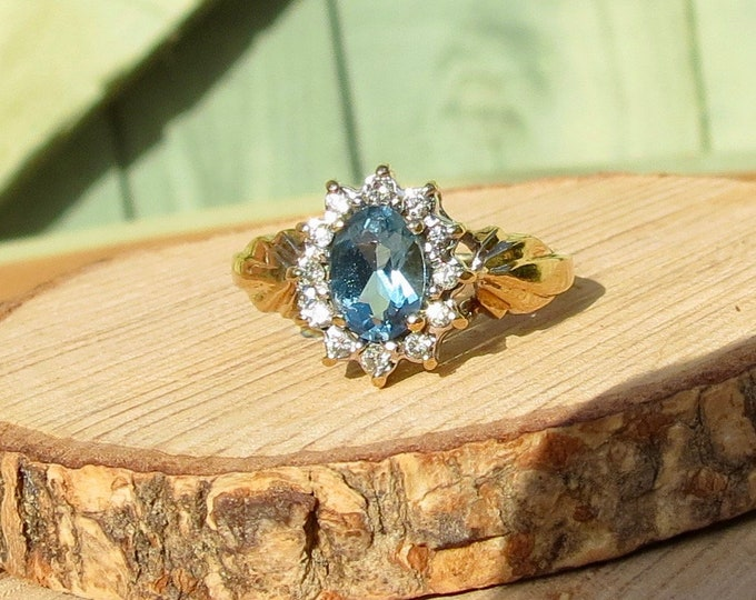 Vintage 9k yellow gold London blue topaz and diamond ring