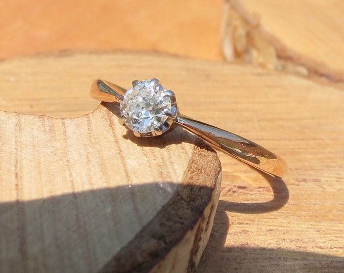 Diamond gold ring. Vintage 1/3 Carat 18k rose gold round cut multi-faceted solitaire diamond ring.