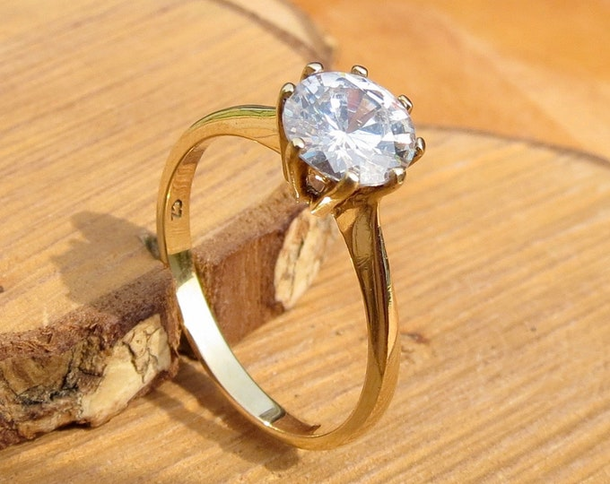 Gold CZ ring. A 9K yellow gold 1 carat solitaire cubic zirconia ring.