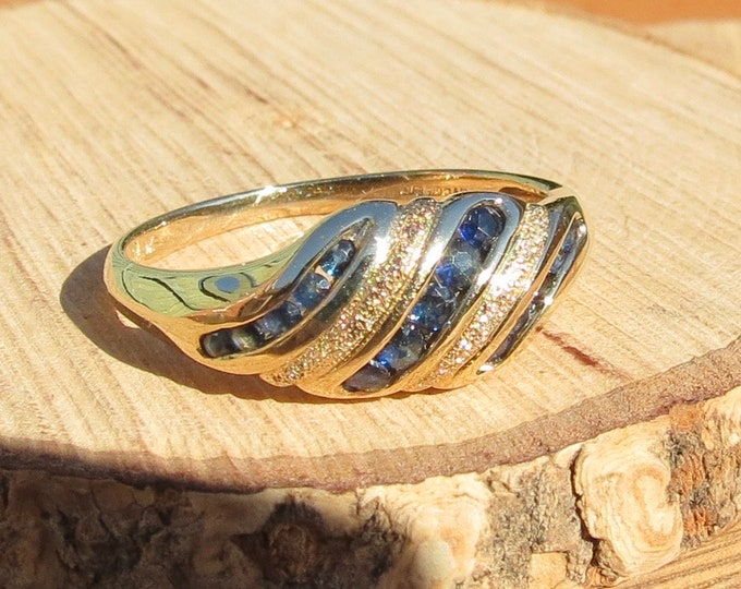 Gold sapphire ring. A 9k yellow gold round cut sapphire ring