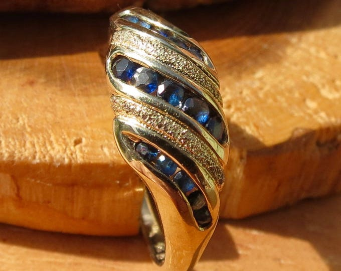 A vintage 9k yellow gold round cut sapphire ring