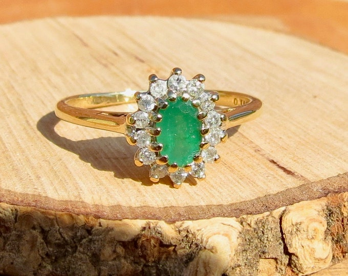 A vintage 9k yellow gold emerald and diamond ring.