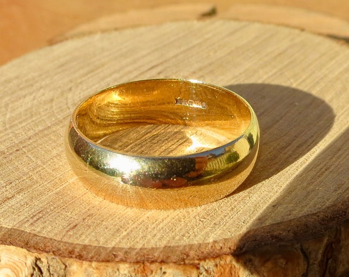 Gold wedding ring. A 9K yellow gold wide court band.