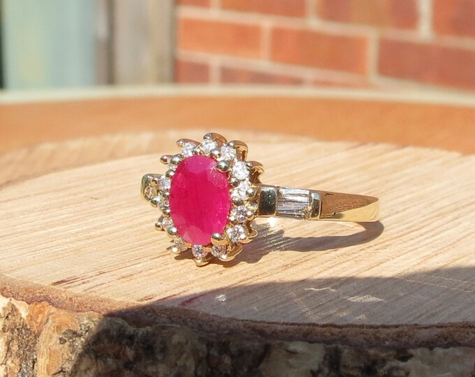 Gold ruby ring. A 9K yellow gold 1 carat ruby and diamond ring.
