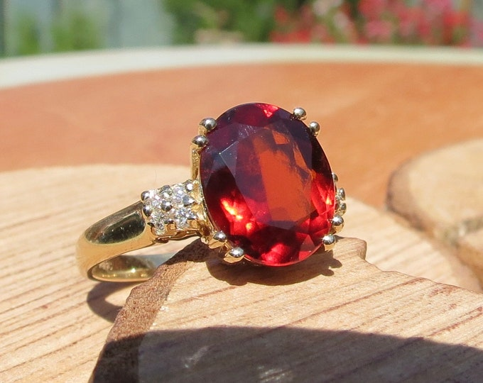 Gold garnet ring. Solitaire 4 carat red garnet with diamond accents in 10k yellow gold.