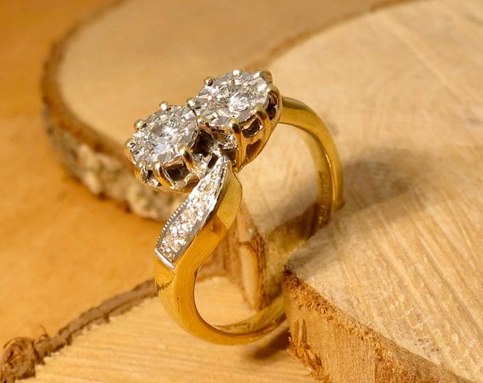 Gold diamond ring. Small sized 18k yellow gold twin 1/4 carat diamond crossover ring. Free Resizing