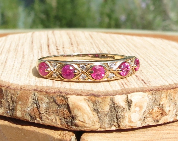 Gold ruby ring. Petite 9K yellow gold ring, with round cut pink rubies and diamond accents