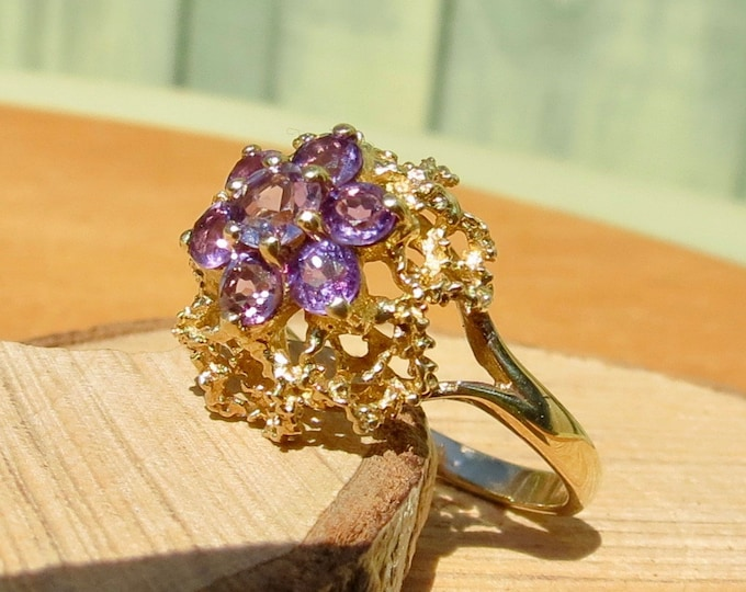A 9k yellow gold amethyst cluster ring