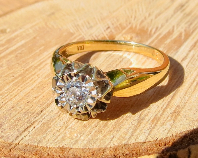 Gold diamond ring. A 9k yellow gold diamond solitaire ring