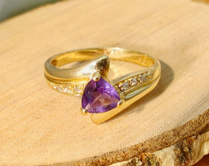 Gold amethyst ring A 10k yellow gold amethyst and diamond accented ring
