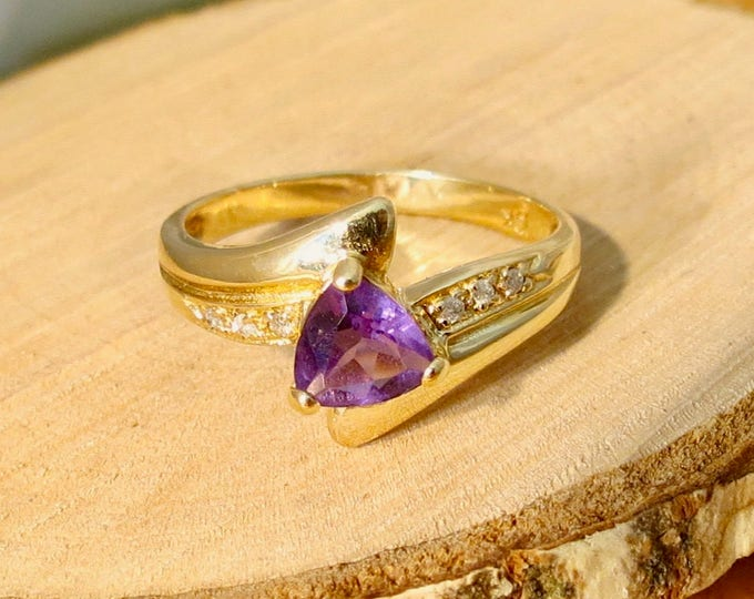 A 10k yellow gold amethyst and diamond accented ring