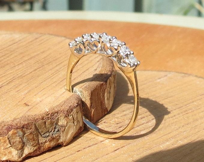 Gold diamond ring. Petite 9K yellow gold 8 diamond ring. Make a great stacker.