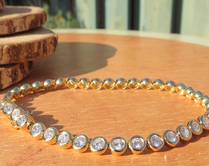 Gold Diamond bracelet, 5 carat of diamonds, 18K yellow gold bezel set white diamonds.