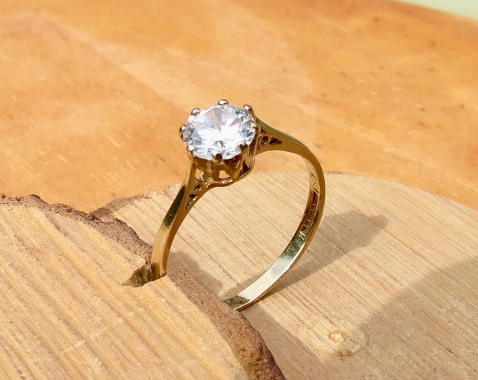 A 9K yellow gold 3/4 carat solitaire cubic zirconia ring.