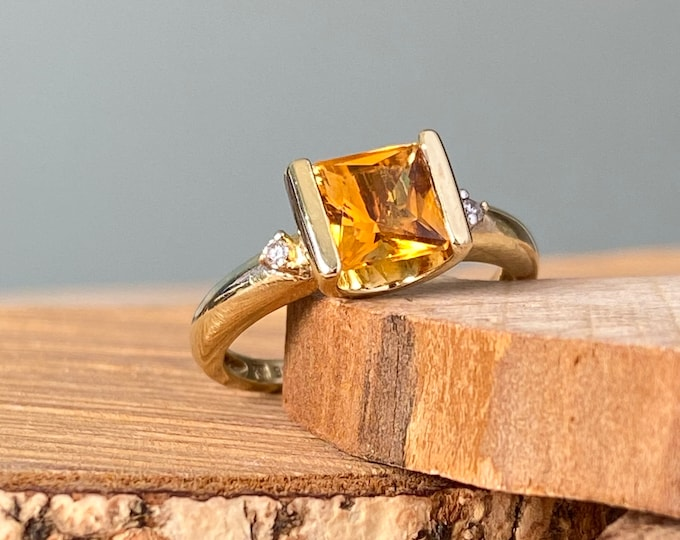 Gold citrine ring. 9K yellow gold princess cut yellow citrine and diamond ring.