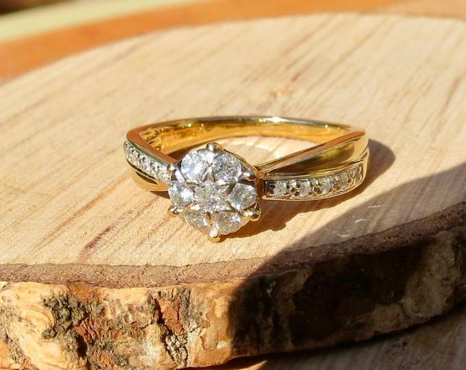 Gold diamond ring. A petité 9k yellow gold 1/4 carat diamond daisy ring.