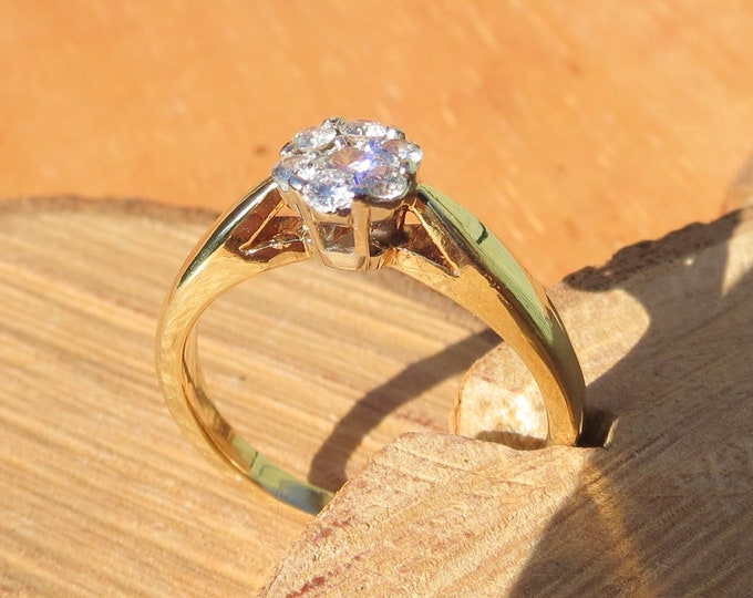 Gold diamond ring. 18K yellow gold 7 diamond cluster ring. 7 is a lucky number for some.