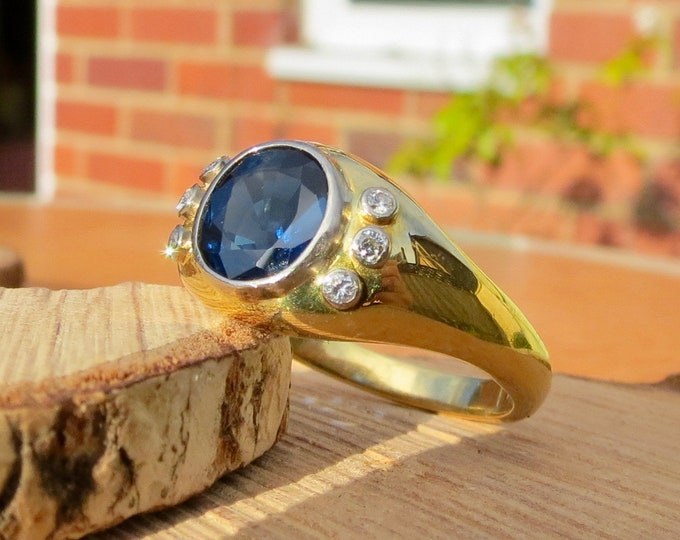 Gold sapphire ring. An 18K yellow gold 1.5 carat sapphire and diamond ring.