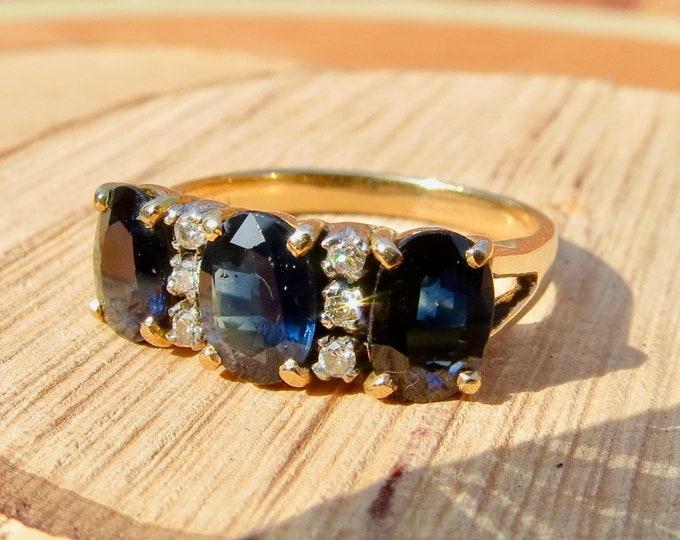 18K yellow gold 3 Ct sapphire and diamond ring.