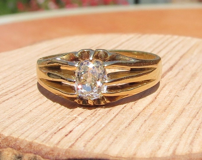 Gold diamond ring, 2/3 carat 'old mine cushion cut' diamond solitaire in 18K gold. Antique dated 1909.
