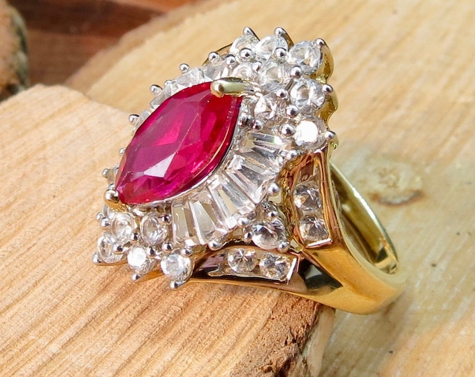 Gold ruby ring. A 10K yellow gold synthetic ruby and white stone ring cocktail ring.