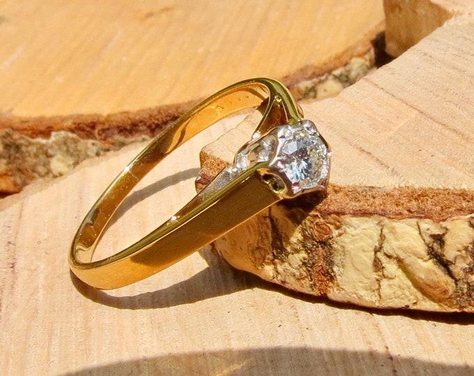 Gold diamond ring. An 18k yellow gold vintage 1/5 carat diamond solitaire ring