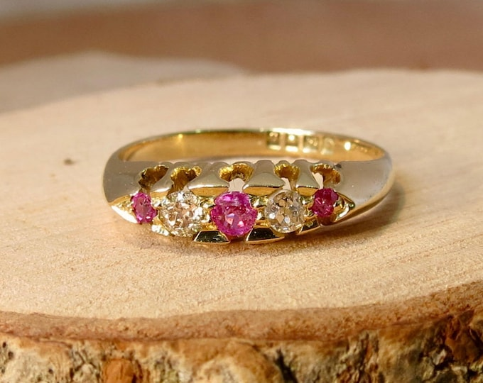 Gold sapphire ring. An antique 18K yellow gold 'old mine cut' diamond and natural pink sapphire ring, made in 1919
