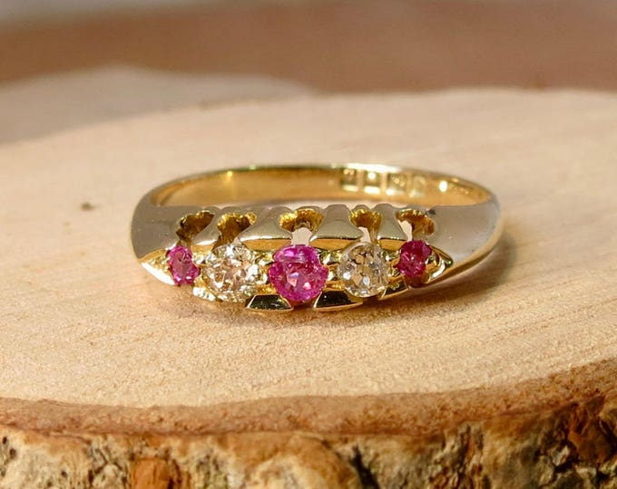 An antique 18K yellow gold 'old mine cut' diamond and natural pink sapphire ring, made in 1919