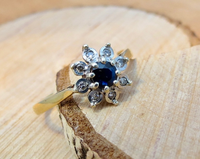 9K yellow gold sapphire and diamond daisy ring.