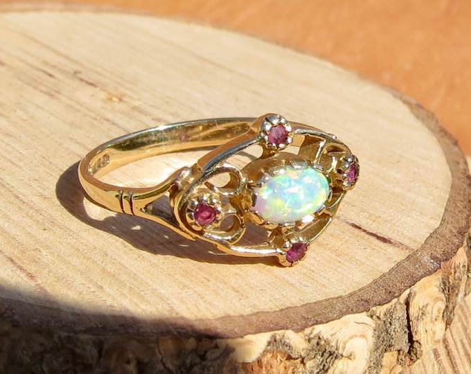 A 9K yellow gold ruby and opal ring.