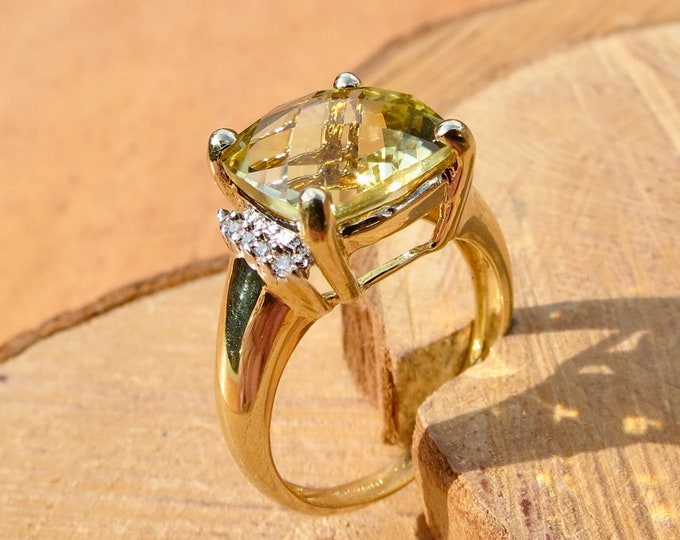 9K yellow gold 7 carat chrysoberyl and diamond ring.