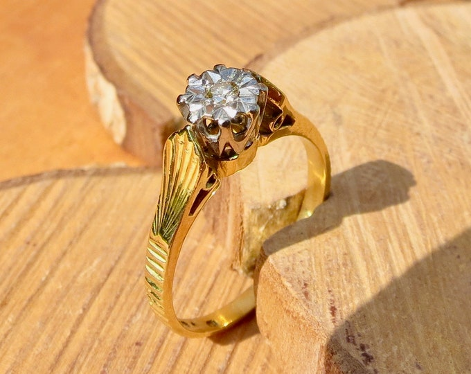 A  diamond solitaire 22k yellow gold ring.