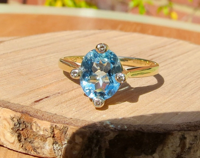 Gold topaz ring. A 9k yellow gold 2.5 carat sky blue topaz and diamond ring