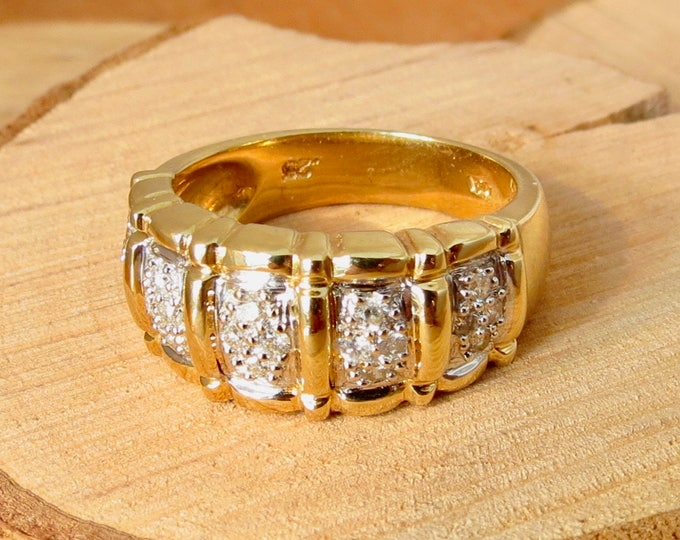 Wide band 14K yellow gold 1/4 carat diamond ring.