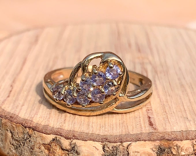 Gold amethyst ring. A 9k yellow gold amethyst multi-stone ring, Pale lilac shades of amethyst are known as 'rose of France'.