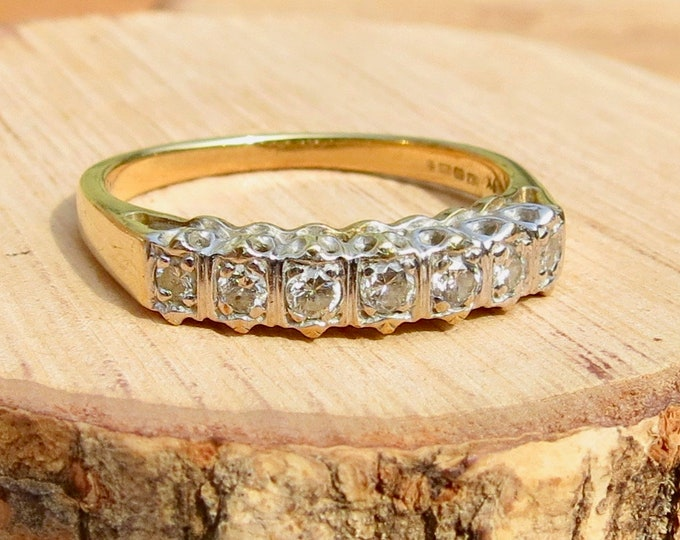 A 9k yellow gold 7 diamond ring.