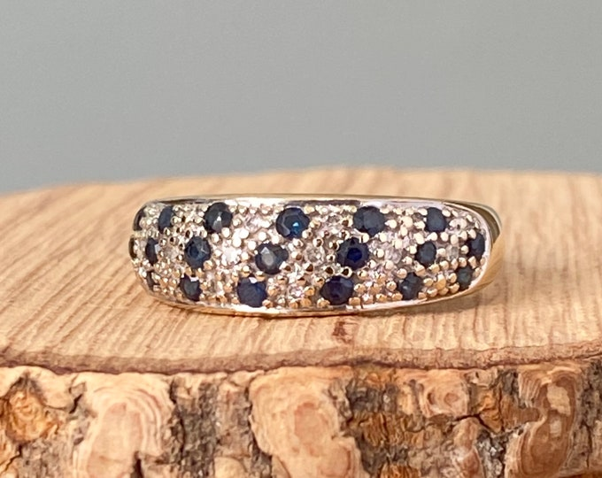 Gold sapphire ring. A 9K yellow gold wide band ring with sapphires and diamonds in a diagonal setting.