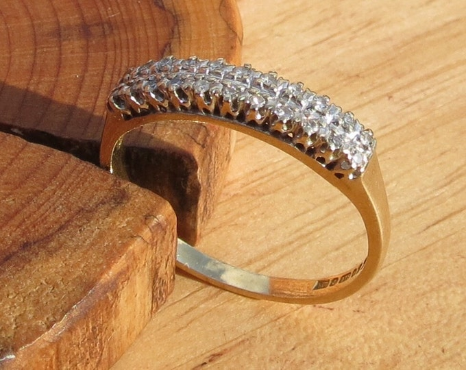 A fine vintage 9k yellow gold 22 diamond ring.
