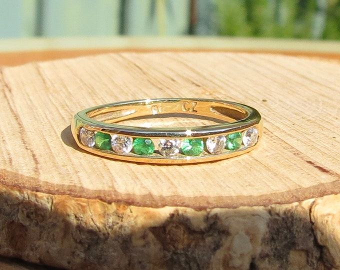 Gold CZ ring. A small sized 9k yellow gold green and white and cubic zirconia ring