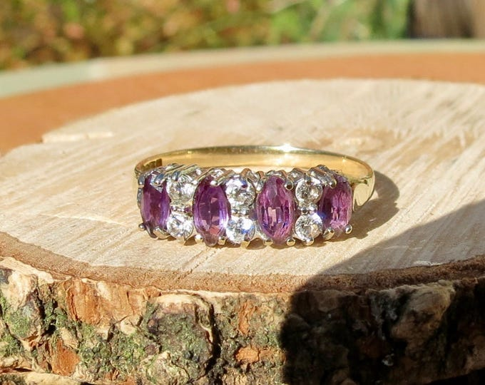 A vintage 9k yellow gold marquise cut amethyst set and white stone ring
